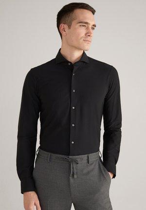 Kostymskjorta - schwarz
