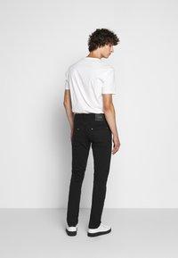 Just Cavalli - PANTALONE - Slim fit jeans - black - 2