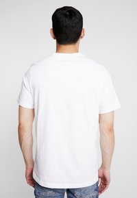 Jordan - T-shirts print - white/black