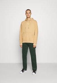 Karl Kani - PANTS - Trousers - green - 1