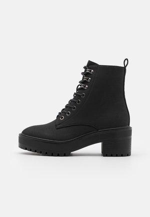 VMTESS BOOT - Platform ankle boots - black/plain