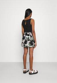 Vero Moda - VMSIMPLY EASY SHORT SKATER SKIRT - Mini skirt - black - 2