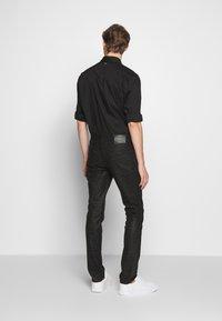 Just Cavalli - ANIMAL PATTERN PANTS 5 POCKETS - Jeans Slim Fit - black - 2