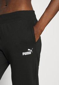 Puma - Pantalon de survêtement - black - 3