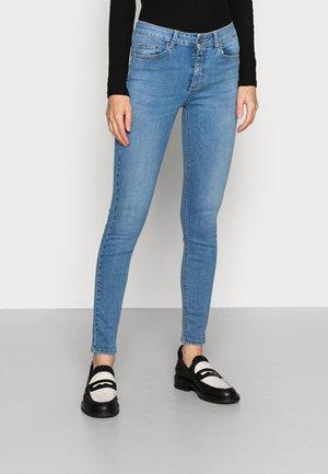 DIVINE - Jeans Skinny Fit - light-blue denim