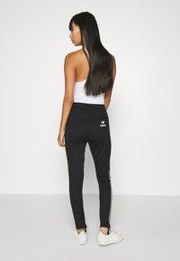 adidas Originals - 70S PANT - Leggings - Trousers - white/black - 2
