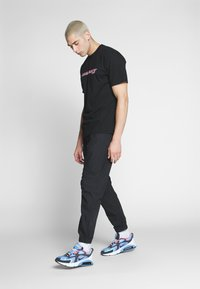 Carhartt WIP - COLTER PANT - Trousers - black/white - 1