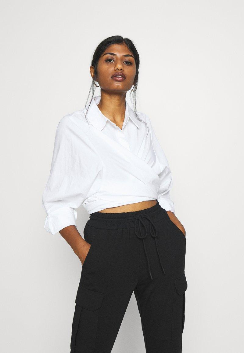 Vero Moda Petite - VMEVA STRING PANT  - Tracksuit bottoms - black