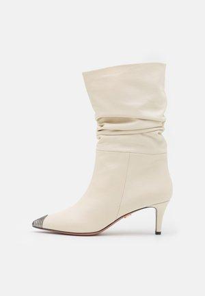 SARA - Classic ankle boots - positano milk