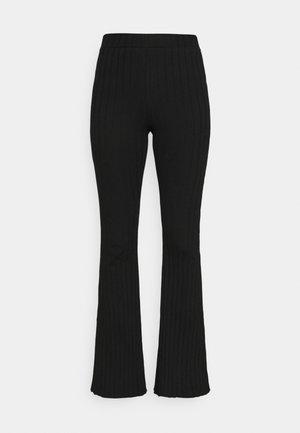 NOA FLARE PANTS WOMEN - Leggings - Trousers - black