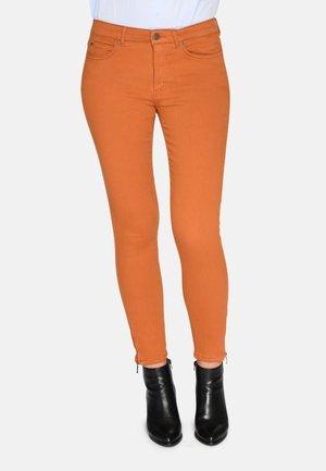 Slim fit jeans - dark orange