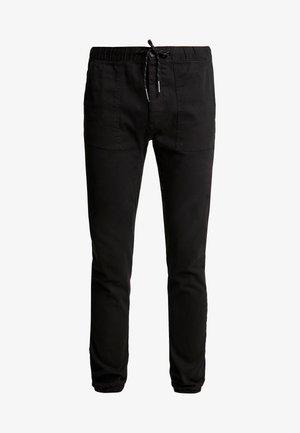 UPDATE SKINNY WOVEN  - Trousers - black