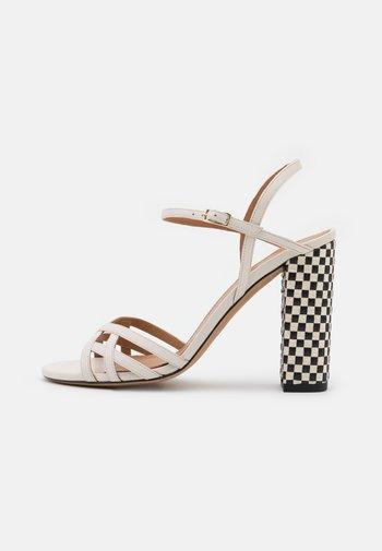 High heeled sandals - latte/royal