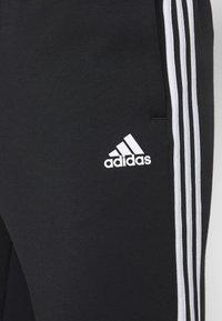 adidas Performance - STRIPES MUST HAVES SPORTS REGULAR PANTS - Verryttelyhousut - black - 5