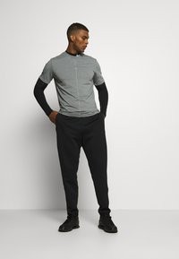 Nike Performance - DRY TEE YOGA - Basic T-shirt - iron grey/smoke grey - 1