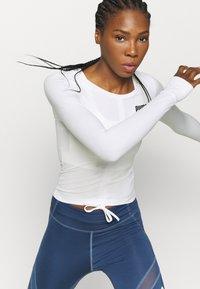 Puma - PAMELA REIF X PUMA COLLECTION RUSHING - Sports shirt - star white - 4