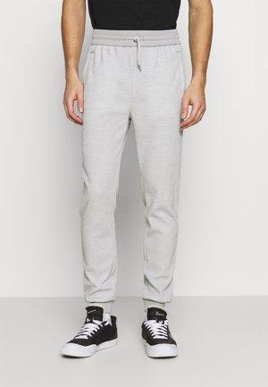 SOJOGGY - Pantaloni sportivi - gris
