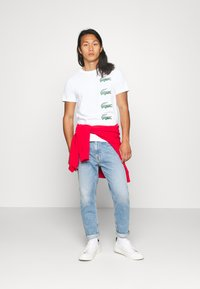 Lacoste - T-shirt con stampa - blanc - 1