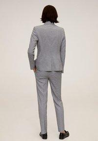 Mango - BORECUAD - Trousers - schwarz - 2
