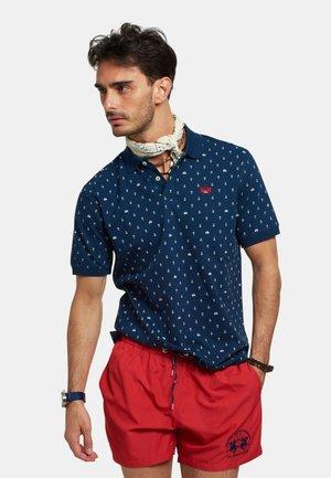 ROMENO - Polo shirt - navy/optic white