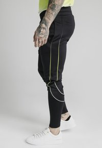 SIKSILK - Tracksuit bottoms - black/white - 3