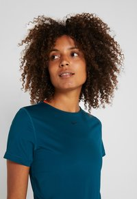 Nike Performance - ALL OVER - T-shirts basic - midnight turquoise/black - 4