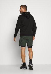 Peak Performance - TRACK SHORTS - Sports shorts - drift green - 2