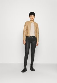 Freaky Nation - EMELLIE - Leather jacket - iced coffee - 1