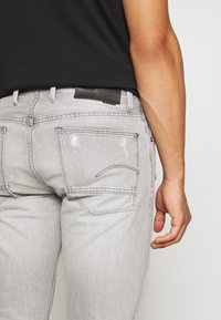 G-Star - ALUM RELAXED TAPERED - Relaxed fit jeans - sato black denim/sun faded ripped pewter grey - 6