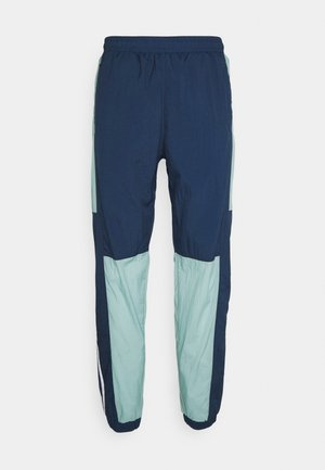 LIGHTWEIGHT UNISEX - Tracksuit bottoms - hazy green/crew navy