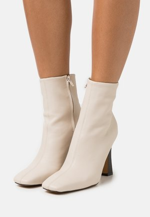 FLARED BOOTS - Classic ankle boots - nude