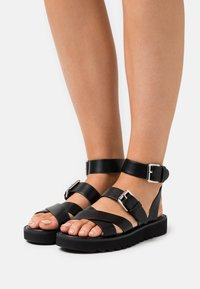 ONLY SHOES - ONLMALU CHUNKY WRAP - Platform sandals - black - 0