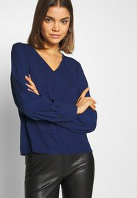 ONLY - ONLFRANCY LIFE V-NECK - Blouse - black/tiny electric leo/sodalite