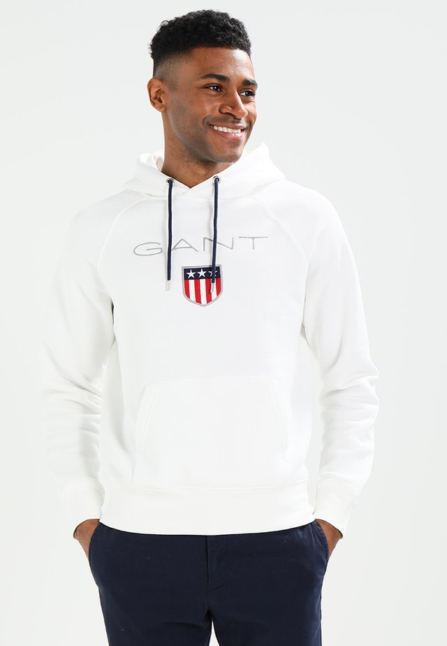 SHIELD HOODIE - Jersey con capucha - egg shell