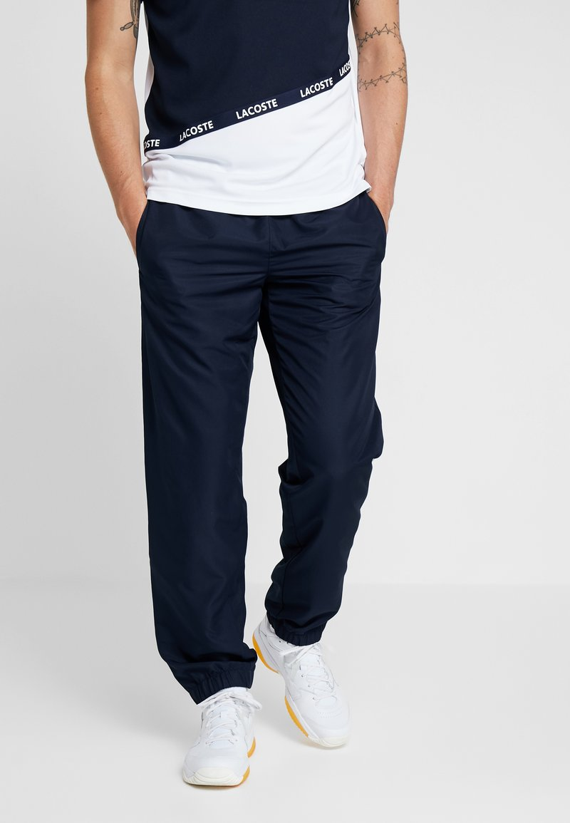 Lacoste Sport - PANT - Tracksuit bottoms - navy blue/ocean/white