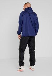 adidas Performance - CORE ELEVEN FOOTBALL JACKET - Hardshell jacket - dark blue/white - 2