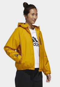 adidas Performance - ADIDAS W.N.D. WARM JACKET - Outdoorjacke - gold - 2