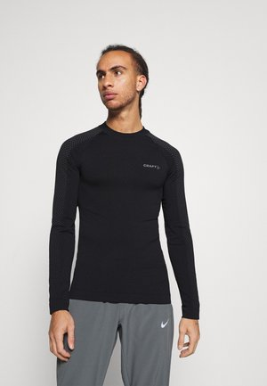 WARM INTENSITY - Long sleeved top - black
