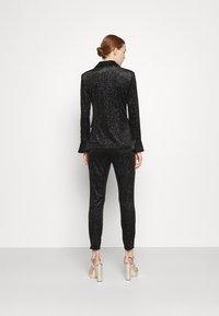 Never Fully Dressed - GLITTER DYNASTY TROUSER - Kalhoty - black - 2