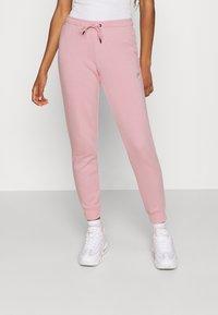 Nike Sportswear - TIGHT - Tracksuit bottoms - pink glaze/white - 0