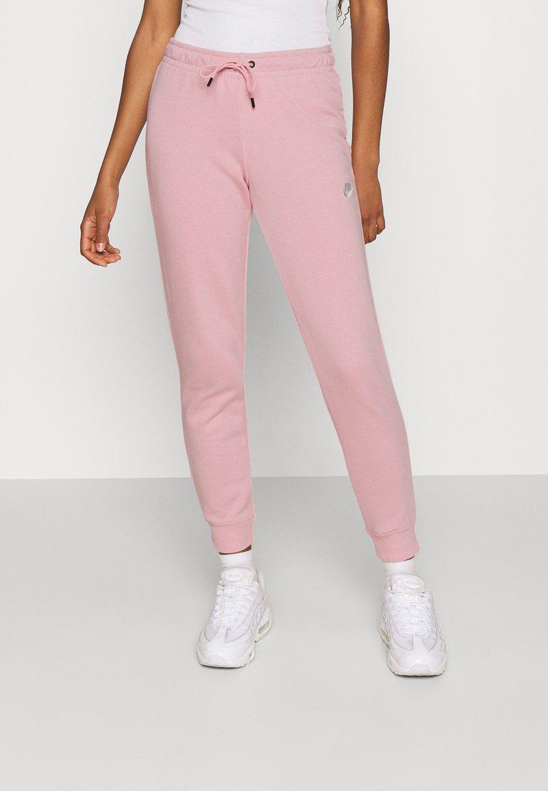 Nike Sportswear - TIGHT - Tracksuit bottoms - pink glaze/white