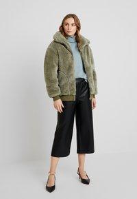 Louche - Winter jacket - green - 1