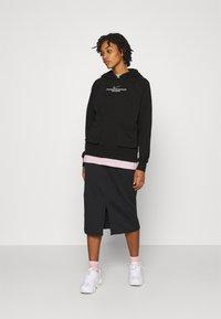 Nike Sportswear - HOODIE - Sudadera - black/white - 1