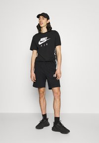 Nike Sportswear - AIR - Träningsbyxor - black/dark smoke grey/white - 1