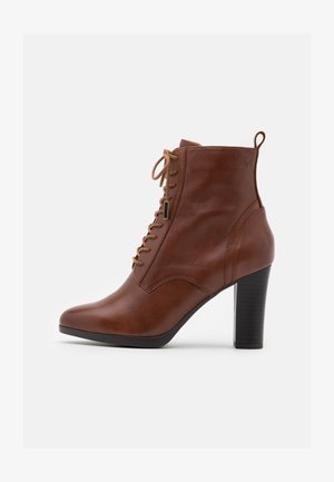 BOOTS - High heeled ankle boots - cognac