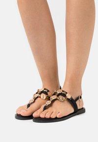 Laura Biagiotti - T-bar sandals - black - 0
