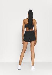 Nike Performance - RUN SHORT - Korte sportsbukser - black - 2