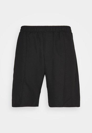 CHASE - Shorts - black