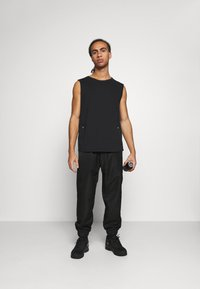 NU-IN - SHELL JOGGERS - Tracksuit bottoms - black - 1