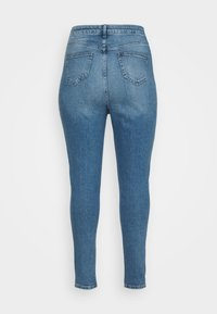 New Look Curves - RIPPED MOM HUFFLEPUFF - Slim fit jeans - mid blue - 1